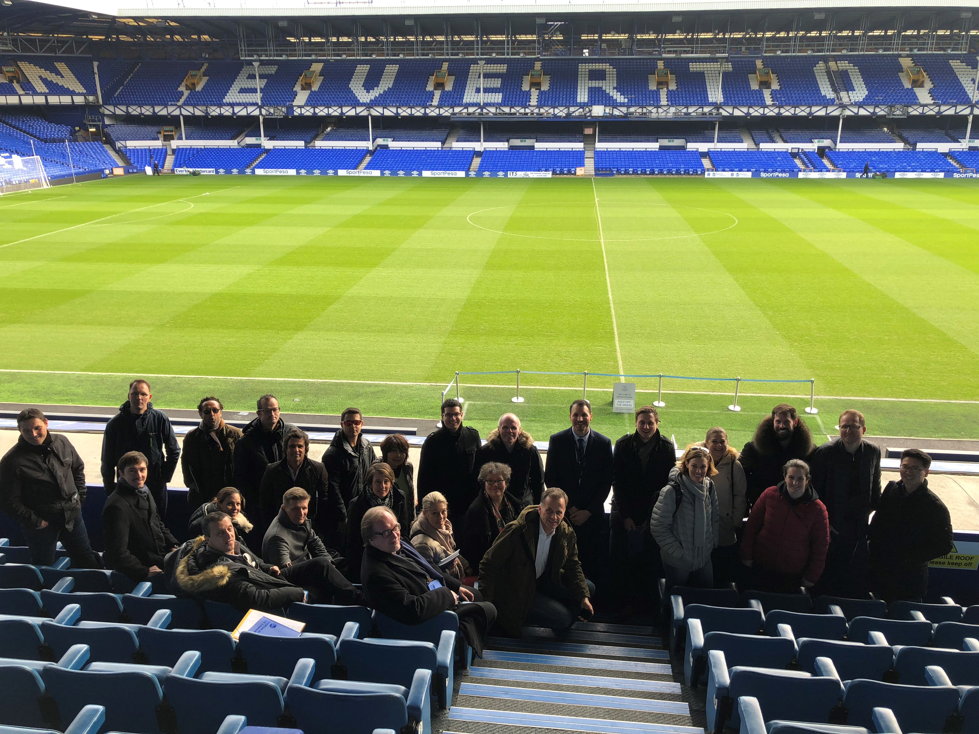 Workshop participants standing in the Everton stadium
